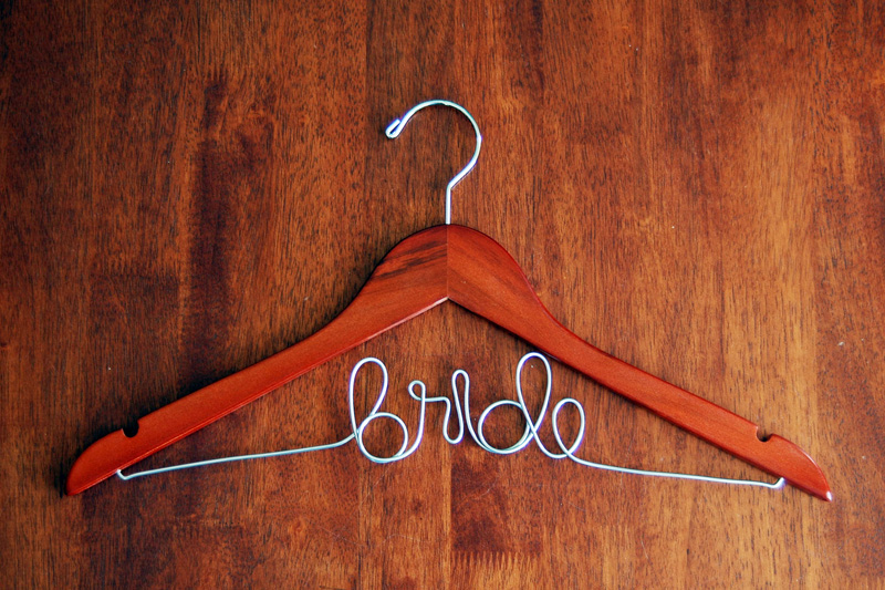 For your bridesmaids (and self, of course), get these adorable personalized  hangers. This keepsake can be reused for years and years after the wedding.
